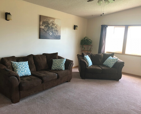 Local Progressive Living Solutions group home with large living area.